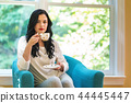 Young woman drinking coffee 44445447