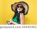 Young woman with a suitcase travel theme 44445463