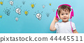 Many light bulbs with toddler boy with headphones 44445511