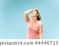 Woman having headache. Isolated over pastel background. 44446713