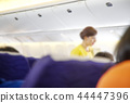 Blurred Flight serving passengers 44447396