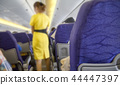Blurred Flight serving passengers 44447397