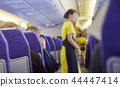 Blurred Flight serving passengers 44447414