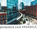 Elevated train curving through Chicago 44449415
