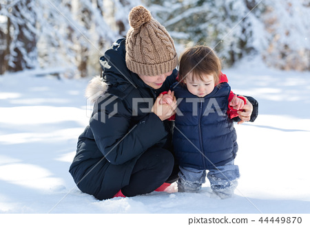 Toddler boy playing in the snow 44449870