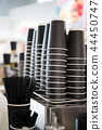 Black paper cups on a counter against the background of a blurred coffee bar at mall with takeaway 44450747