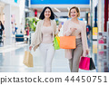 Young attractive girls with shopping bags at mall 44450751