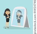 businesswoman looking  standing in front mirror 44454746