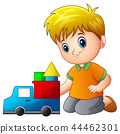 Little boy house out of blocks with toy truck 44462301