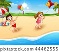 Children playing a kites on the beach 44462555
