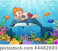 Cartoon boy with dolphin swimming 44462603