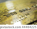 Gold credit cards close up. Macro shot smart card, credit card 44464225