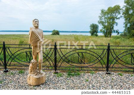 Wooden sculpture of a musician playing  44465315