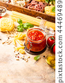 Glass jar with homemade classic spicy tomato pasta or pizza sauce. 44469489