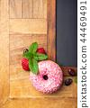 Black chalkboard with pink glazed donut 44469491