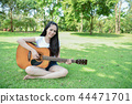 Music Concepts. Asian girls playing guitar. Asian women relaxing 44471701