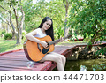 Music Concepts. Asian girls playing guitar. Asian women relaxing 44471703