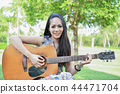 Music Concepts. Asian girls playing guitar. Asian women relaxing 44471704