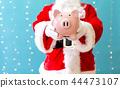 Santa holding a piggy bank 44473107
