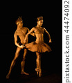 Professional, emotional ballet dancers with crowns on dark smoke scene performed by sexual couple 44474092