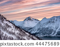 Snowy mountain peak with colorful streak sky 44475689