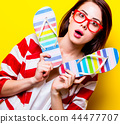 portrait of the young woman with sandals 44477707