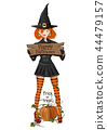 Cute girl in a Halloween witch costume 44479157