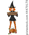 Cute girl in a witch costume holding a sign 44479179