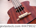 Ukulele guitar on wooden background 44479632