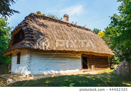Old log house with thatched roof 44482385