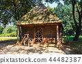 Old log house with thatched roof in Poland 44482387