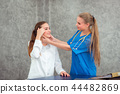 Female doctor surgeon is examining physical female 44482869