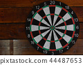 dart board hang on wooden wall 44487653