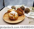 Chocolate and vanilla choux cream puff with candle 44488049