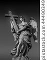 Catholic angel with cross 44490349
