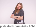 Fashion, style and people concept - attractive young woman with crossed arms over white background 44491261