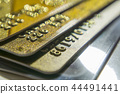 Gold and platinum credit cards close up 44491441