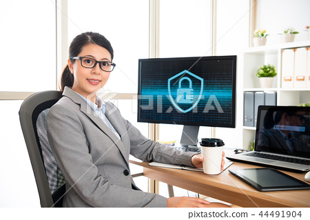 confident woman sitting in her office 44491904