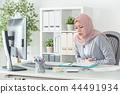 muslim businesswoman having stomachache at work 44491934