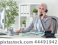 Muslim operator in office suit answering the phone call 44491942