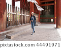 a female tourist relaxing walking in the temple 44491971