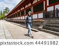 an female traveler walking around the temple 44491982