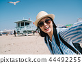 traveler joyfully taking selfie with the seagull 44492255