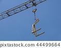 Crane lifting Pallet .Blue sky on background 44499664