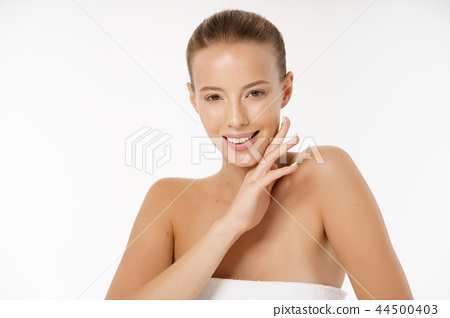 Beautiful young woman with clean fresh perfect skin. Portrait of model with natural nude make up 44500403