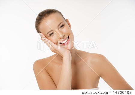 Beautiful young woman with clean fresh perfect skin. Portrait of model with natural nude make up 44500408