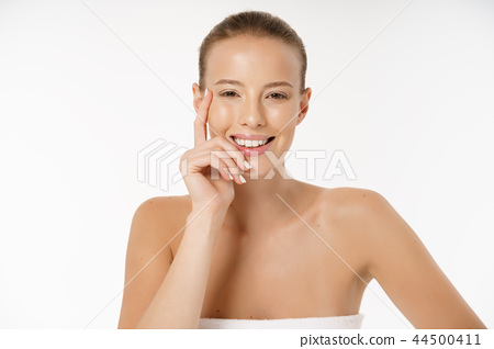 Beautiful young woman with clean fresh perfect skin. Portrait of model with natural nude make up 44500411