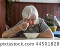 Solitary senior woman eating her lunch at retirement home. 44501828