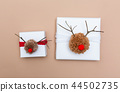 Pompom reindeer gift boxes on brown paper 44502735