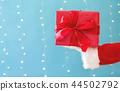 Santa holding a Christmas gift 44502792